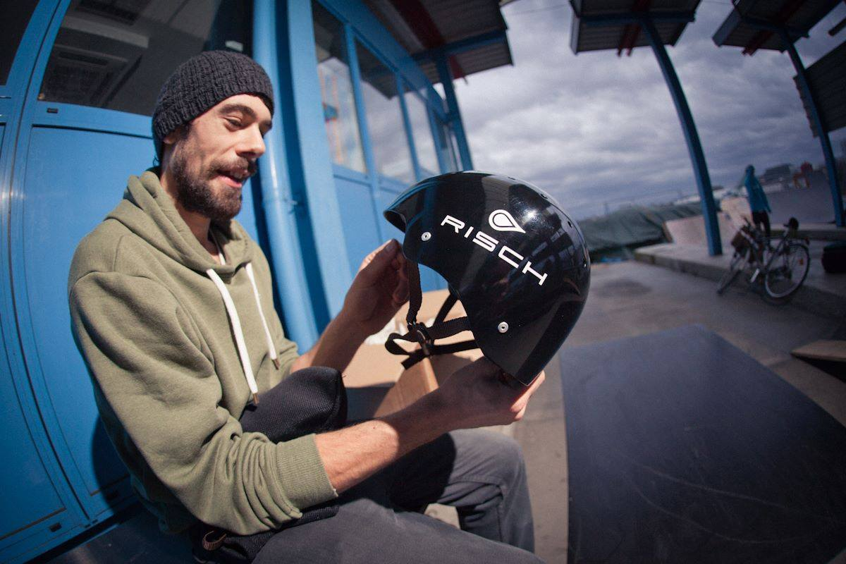 alex inspects helmet